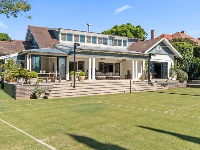 18 Drumalbyn Rd, Bellevue Hill, has a Wimbledon-style glass tennis court.