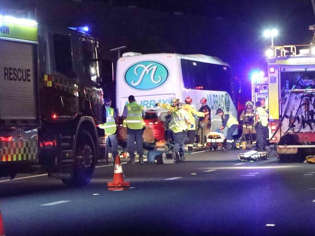Three teens critical after slamming into bus on M5 in Sydney's south