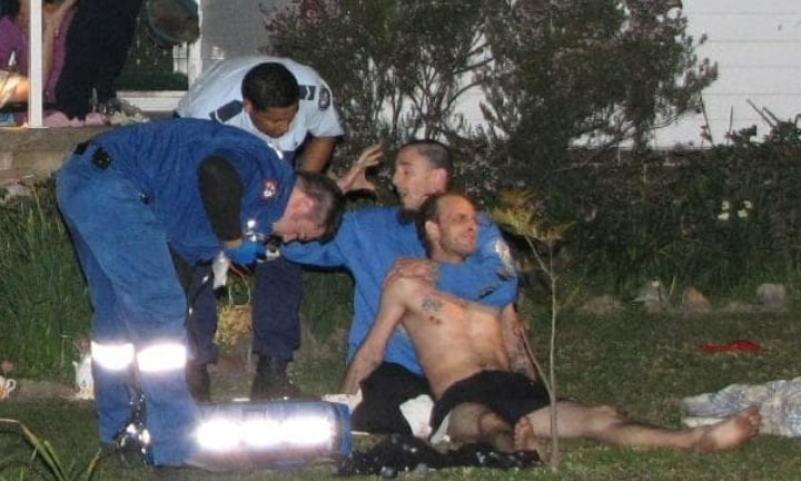 Paramedics treat Robert Leuthwaite Jr for a bullet wound to the chest in the front yard of his home in Werrington, western Sydney, on August 22, 2010.Source:Supplied