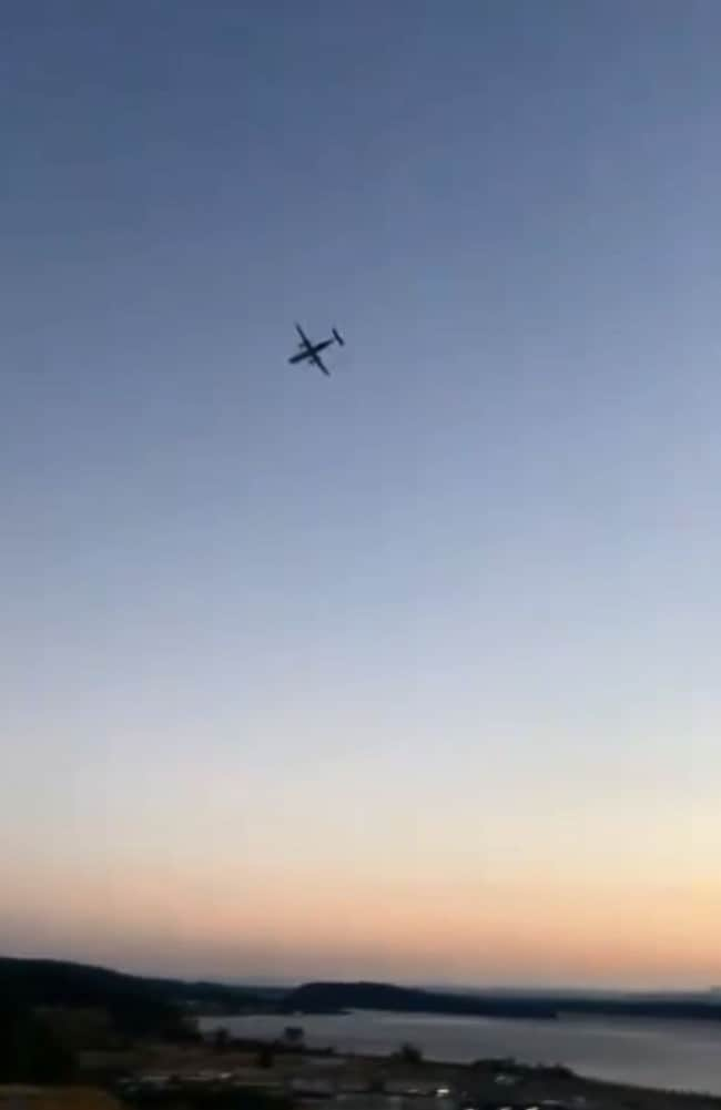 The actual stolen plane videoed by onlookers before it crashed near Seattle after a chase by F15 fighter jets. Picture: @drbmbdgty
