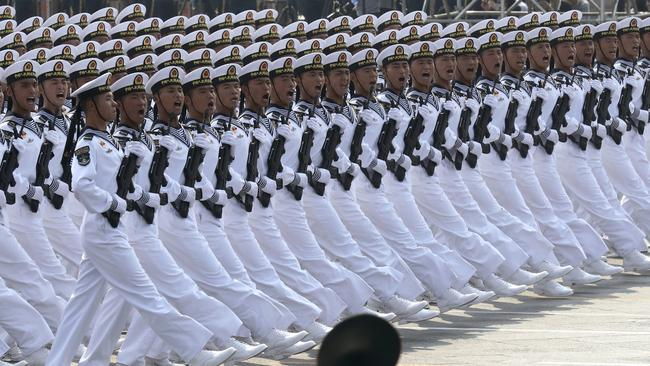 Chinese sailors march during a the parade. Picture: Ng Han Guan/AP