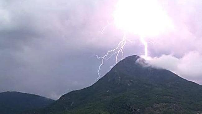Walsh's Pyramid in Gordonvale, south of Cairns, is struck my lightning.