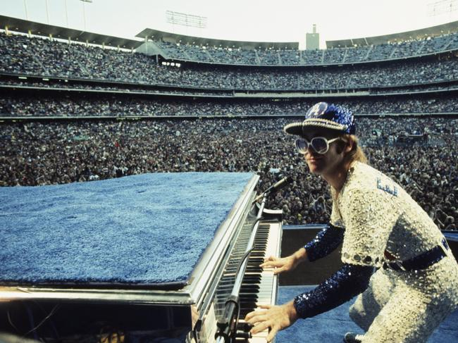English singer songwriter Elton John performing at Dodger Stadium in Los Angeles, 1975. Picture: Terry O'Neill