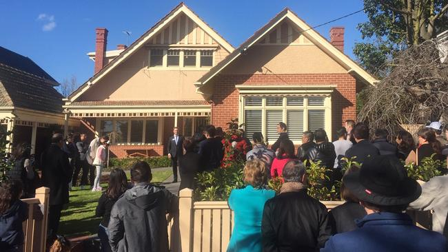 Four bidders and a big crowd attended the auction. Picture: National Property Buyers