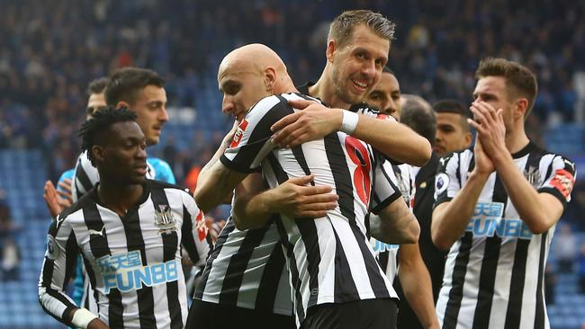 Newcastle United's French midfiielder Florian Lejeune (R) embraces Newcastle United's English midfielder Jonjo Shelvey (L)