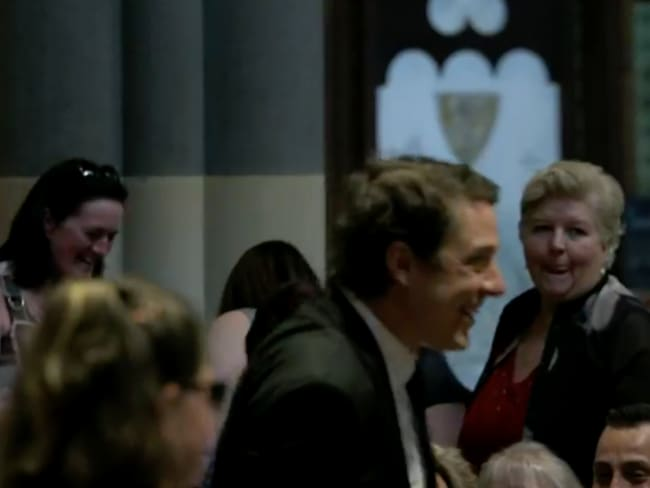 Sam greets guests at the service. Live footage was streamed on social media.