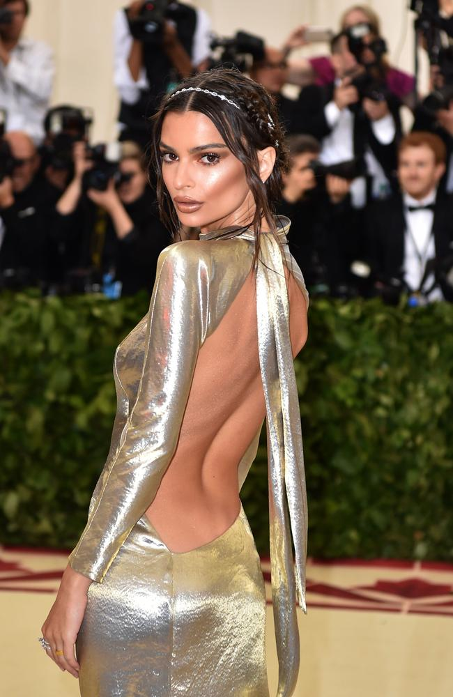 Emily Ratajkowski's 2018 Met Gala look was also very daring, with a racy cut-out on her back. Picture: AFP PHOTO / Hector RETAMAL