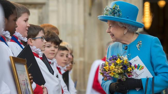 Britain's Queen Elizabeth II greets schoolchildren at the Commonwealth Day service. Picture: AFP/Geoff Pugh