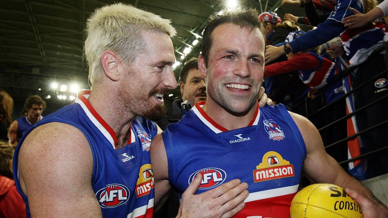 AFL Football - Fremantle vs Western Bulldogs match at Etihad Stadium. Brad Johnson is congratulated by Jason Akermanis after the game.