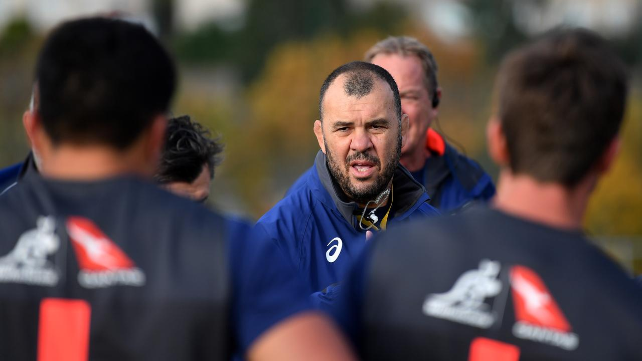 Michael Cheika talks to his players during a training session at Llanwern High School.