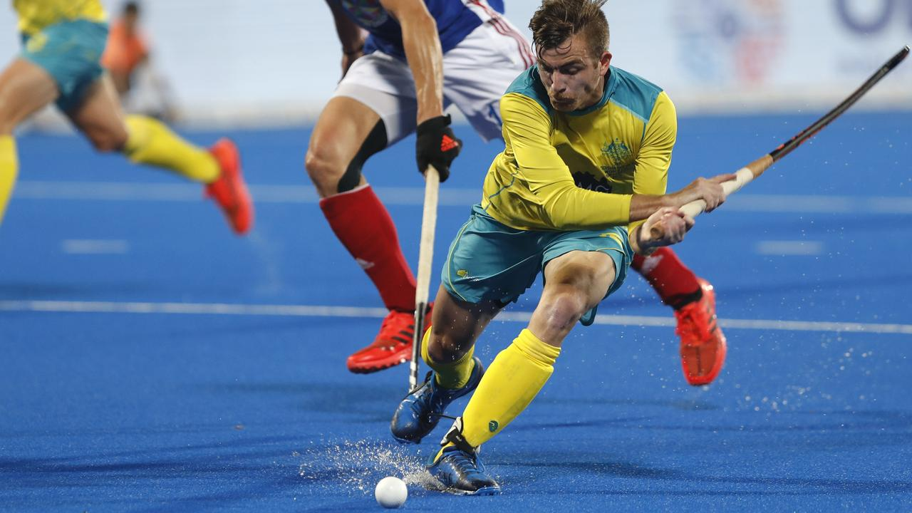 Australia's Jake Whetton takes control of the ball during the Men's Hockey World Cup quarterfinal match between France and Australia. Picture: AP
