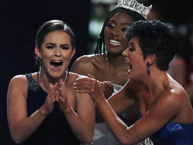 Camille Schrier, of Virginia, left, reacts after winning the Miss America competition. Picture: AP