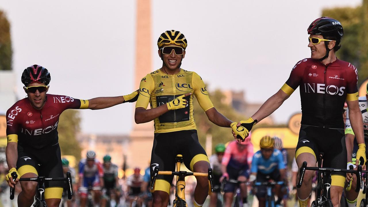 Spain's Jonathan Castroviejo (L) and Great Britain's Geraint Thomas (R) congratulate Colombia's Egan Bernal, the youngest Tour winner in 110 years.
