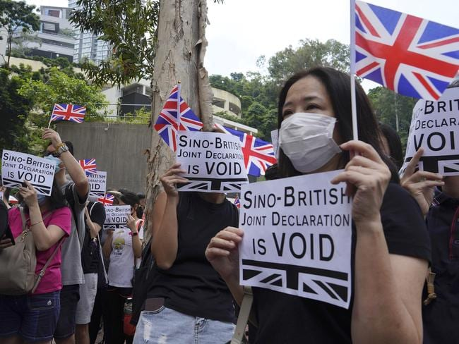 Hundreds of activists rallied outside the British Consulate, bolstering calls for international support in their months-long protests for democratic reforms. Picture: AP Photo/Vincent Yu