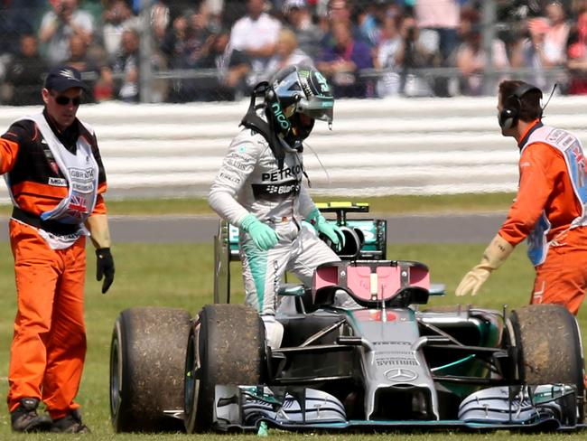 Mercedes' German driver, Nico Rosberg, climbs out of his car after it broke down.
