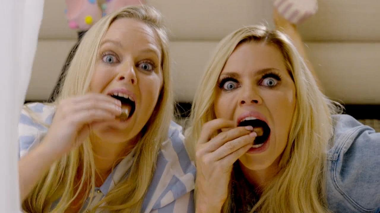 Sophie Monk and sisters share a Tim Tam night in