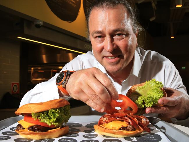 Neil Perry pictured with his new range of burgers at Burger Project in World Square. Chef David Chang has caused controversy by saying Australia 'f*@% up burgers' more than anyone else in the world, Perry disagrees. Picture: Toby Zerna