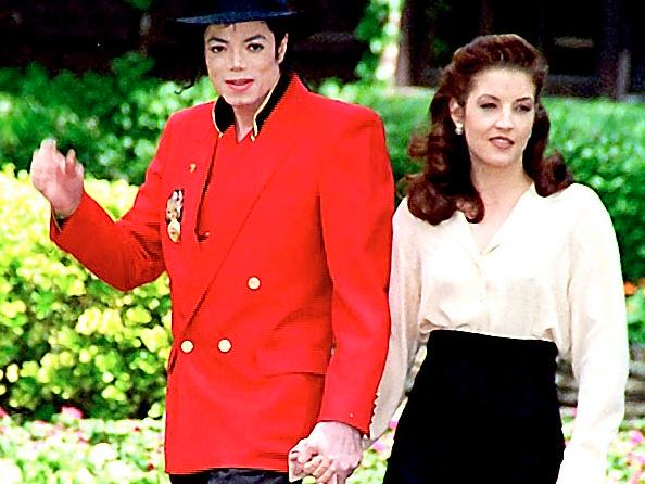 Strolling in the grounds of Neverland in 1995 with Lisa Marie Presley, who he married after a whirlwind romance the previous year.
