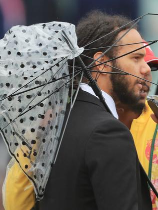 We hope this lad had better luck on the punt than he did with his umbrella.