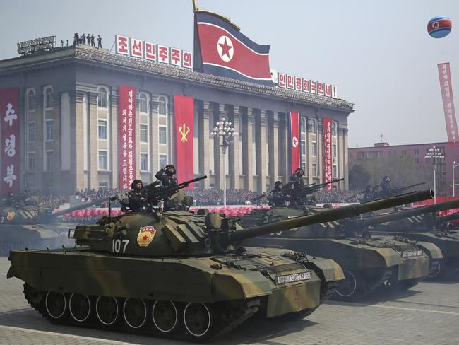 Soldiers in tanks take part in a military parade in Pyongyang. Picture: AP
