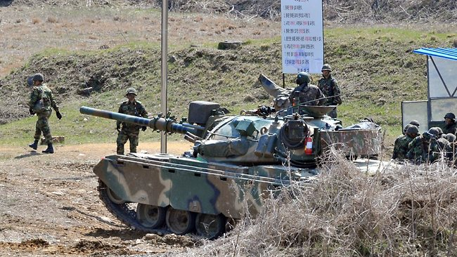 A South Korean army tank moves at a shooting range in the border city of Paju.