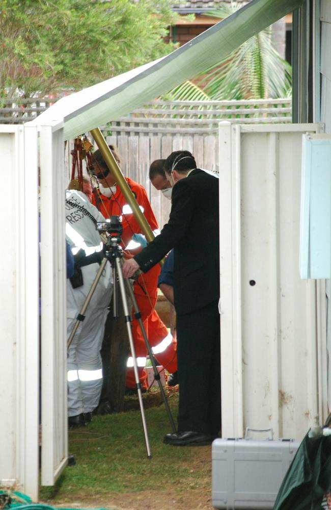 Forensic officers at the Bellambi property where Louise O'Brien's remains were dug in inside a wheelie bin.