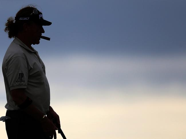 Spain's Miguel Angel Jimenez lines his putt on the 13th green during a practice round.