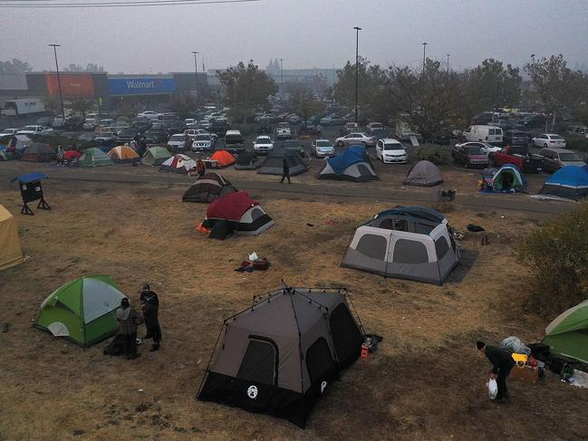 Tents are seen pitched in a field next to a Walmart parking lot where Camp Fire evacuees have been staying in Chico, California. Picture: AFP