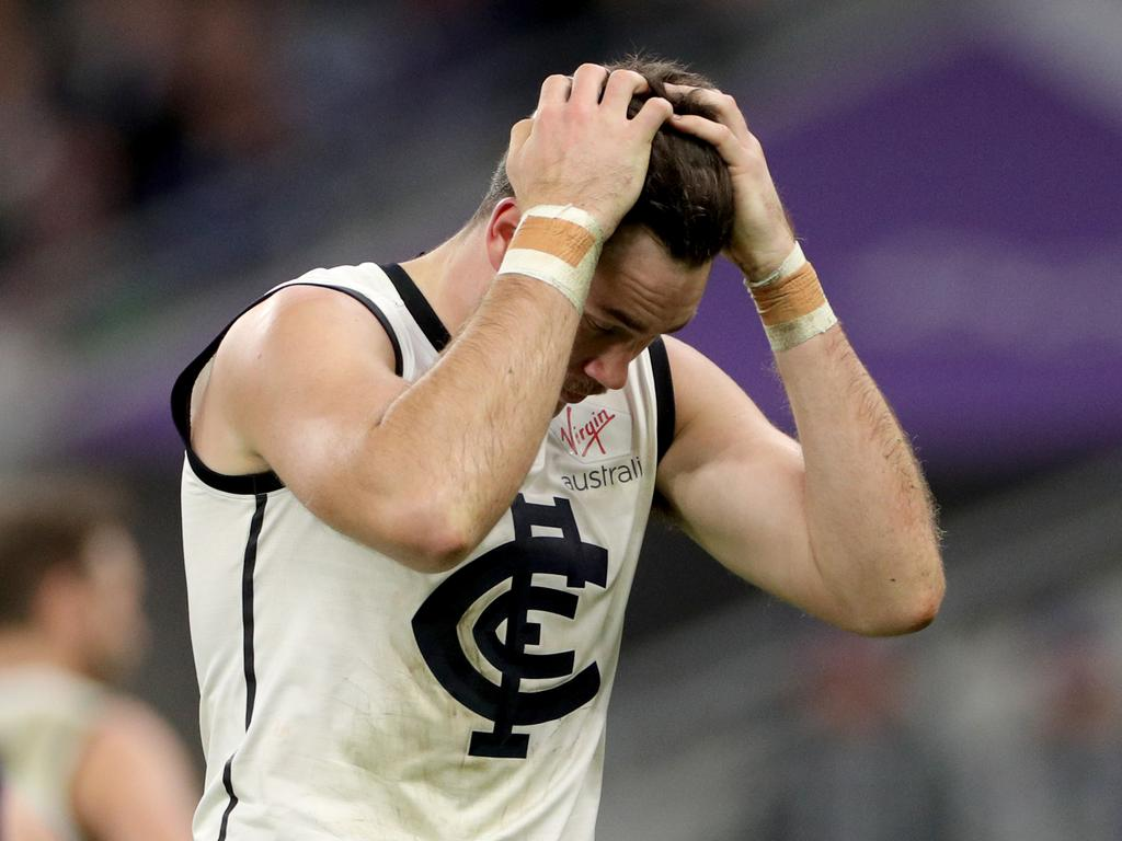 Mitch McGovern of the Blues reacts after missing a goal during the Round 15 AFL match between the Fremantle Dockers and the Carlton Blues at Optus Stadium in Perth, Sunday, June 30, 2019. (AAP Image/Richard Wainwright) NO ARCHIVING, EDITORIAL USE ONLY