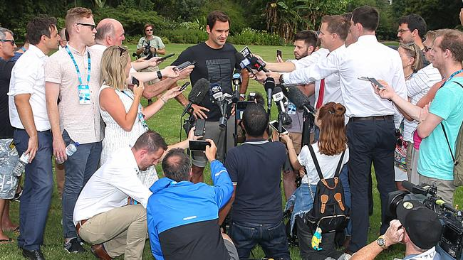 The media circle the sleep-deprived Federer. Picture: Ian Currie