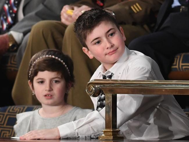 Sixth grade student Joshua Trump and fifth grade student Grace Eline were special guests of the President. Picture: Saul Loeb/AFP