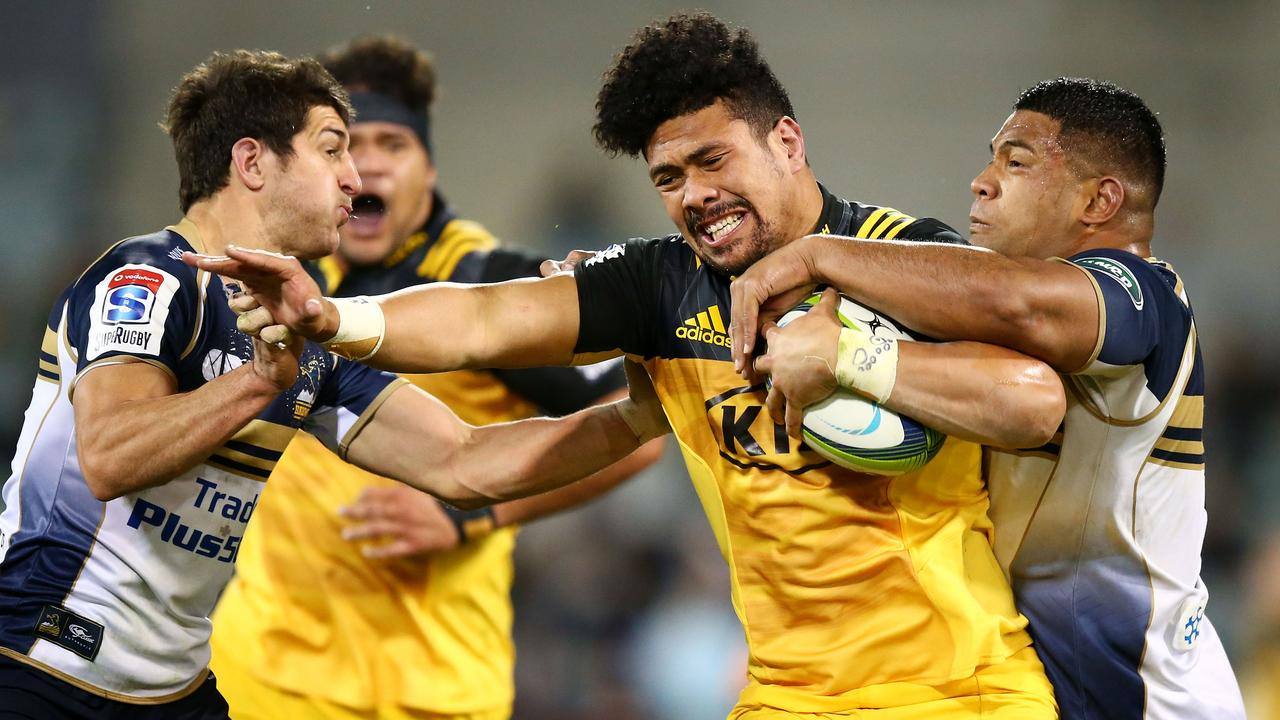 Ardie Savea of the Hurricanes is tackled during the 2017 Super Rugby quarterfinal.