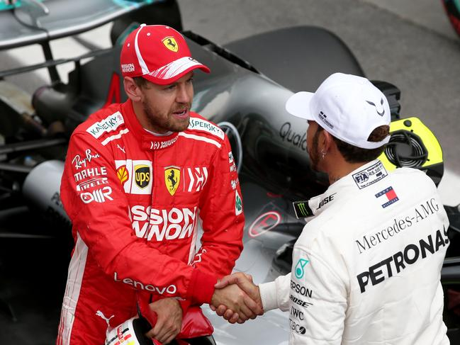 Vettel and Hamilton congratulate each other on another front row pairing.