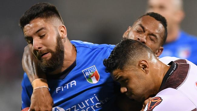 Mason Cerruto of Italy (left) is tackled by Brayden Wiliame of Fiji.