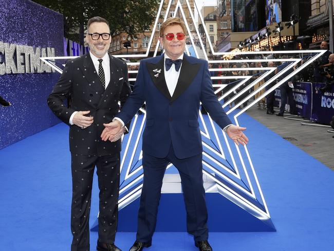 Musician Elton John and his husband David Furnish, left, arrive for the UK premiere of Rocketman in London, Monday, May 20, 2019. Picture: AP Photo/Frank Augstein