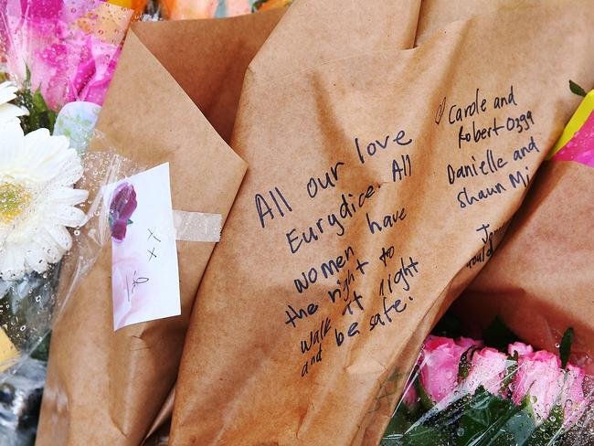 Floral tributes to Eurydice Dixon in Carlton's Princes Park.