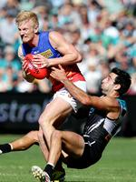 Round 4: A trademark tackle from Dom Cassisi brings down Brisbane's Nick Robertson at Adelaide Oval. Picture: Sarah Reed