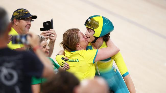 Amy Cure of Australia celebrates with family after winning the Women - Commonwealth Games Day 4 Medal Tally, Swimming, Athletics Results, Kerri Pottharst Racial Comment's Scratch