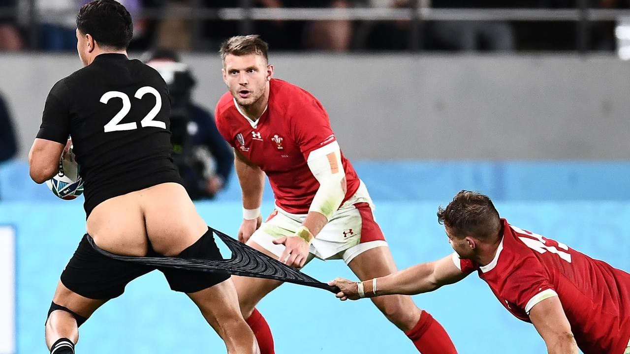New Zealand's Anton Lienert-Brown has his shorts pulled down by Wales' Hallam Amos.