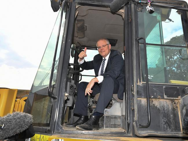 Prime Minister Scott Morrison loves a big piece of machinery. Picture: AAP Image/Mick Tsikas