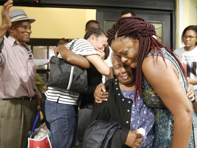Jasmine Farrington, right, greets Martha Eyma after being rescued and flown from devastated Abaco Island to Nassau, Bahamas. Picture: Getty Images