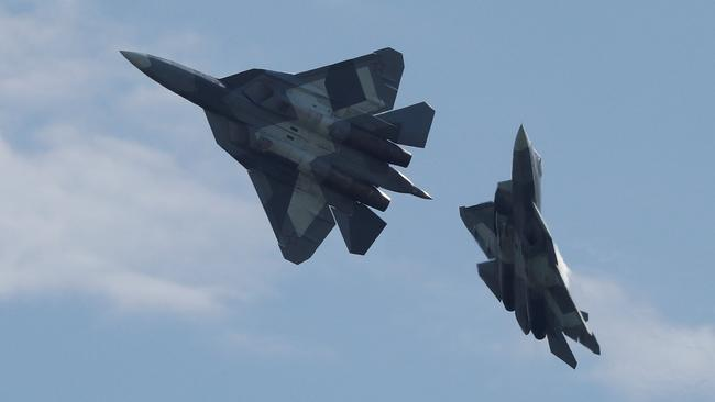Two Su-57 stealth fighters put on a display at a recent airshow. The fighter will not enter full production, reports say.