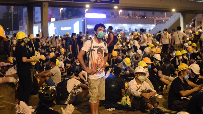 Demonstrators occupy a street the night after a protest against the extradition law.
