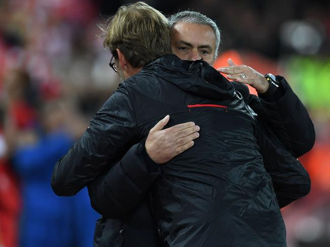 Liverpool's German manager Jurgen Klopp greets Manchester United's Jose Mourinho.