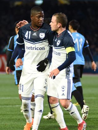 Leroy George (L) is congratulated by teammate midfielder Leigh Broxham after scoring