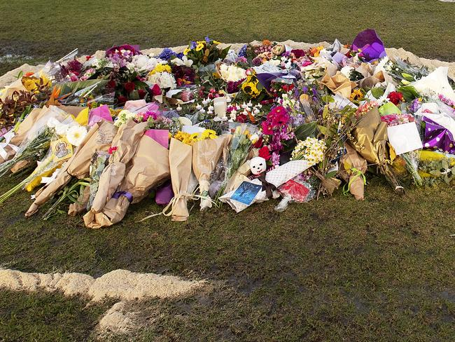 Flowers and notes have been left at Princes Park. Picture: Ellen Smith/AAP