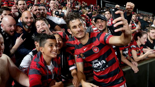 Dario Vidosic gets as selfie with fans after an extra time A-League winner for the Wanderers.