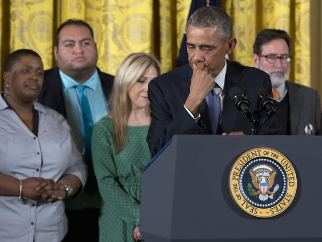 Emotional moment ... President Barack Obama delivers his powerful address surrounded by gun violence victims. Picture: AP Photo/Carolyn Kaster