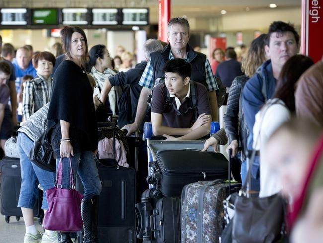 Waiting game ... Passengers faced long queues after an IT fault caused delays to Jetstar flights departing Melbourne. Picture: Nathan Dyer
