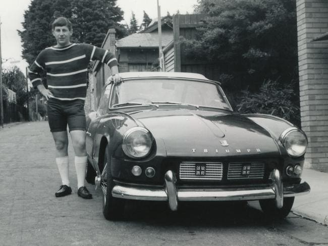 As a young man ... Geoffrey Edelsten with his first car, a Triumph Sports.